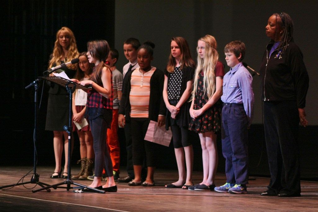 """19 January 2015-Santa Barbara, CA: The Arlington Theater Program; Essay/Poetry Winners-Ages 6-12 with Sojourner Kincaid Rolle and Amanda Kramer.   Essay - Ages 6-12 1st    Jaiani Hammonds      Franklin  2nd  Allison Mooney        Roosevelt 3rd   Maddie Fitz             Roosevelt  3rd   Charlie Hess            Roosevelt  Poetry - Ages 6-12 1st   Celene Sanchez        Roosevelt 2nd  Lola Crane-Flores    Roosevelt 3rd   Owen Rybnicek        Roosevelt 3rd   Jeffrey Helman         Roosevelt  Santa Barbara Honors Dr. Martin Luther King Jr. with a Day of Celebration.  The Santa Barbara MLK, Jr. Committee chose """"Drum Majors for Justice"""" as it's theme for the day which included a Pre-March Program in De la Guerra Plaza followed by a march up State Street to the Arlington Theater for speakers, music and poetry.  The program concluded with a Community Lunch at the First United Methodist Church in Santa Barbara.  Photo by Rod Rolle"""